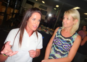 Cassie with a client at our grand opening